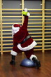 Santa Claus kettlebells training, back view