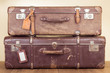Vintage travel valises with leather name tags blanks