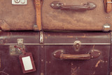 Vintage travel valises with leather tag for background poster