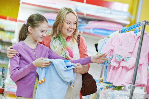 woman and little girl shopping clothes