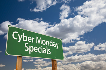 Cyber Monday Specials Green Road Sign and Clouds