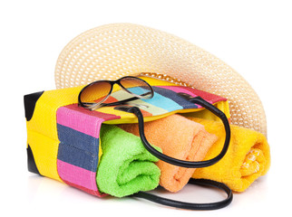 Bag with towels, sunglasses and hat