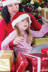 mother and her daughter with cristmas presents