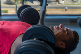 Man Doing Incline Chest Presses With Dumbbells In Gymnasium poster