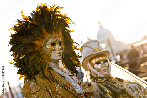 Couple of masked people posing during Venice Carnival