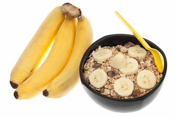 Muesli and fresh banana isolated on white background