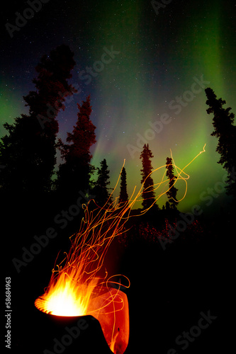Taiga firepit camp fire sparks and northern lights