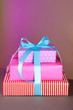 Gift box tied with a ribbon on a color background