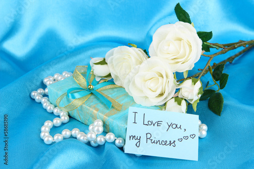Romantic parcel on blue cloth background