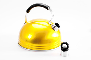 Yellow tea kettle isolated on white background