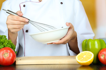 Cook hands whisking mayonnaise