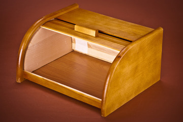 wooden bread box on brown backgroud