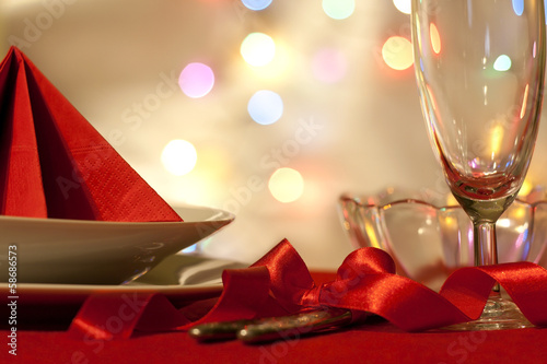 Christmas table abstract background with red ribbon and dishware