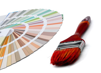Close-up of a color palette and a brush