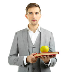 Young teacher with book and apple isolated on white