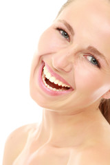 Close-up of excited young woman with healthy complexion