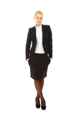 A full-length portrait of a beautiful businesswoman standing