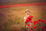A boy with a bouquet of poppies
