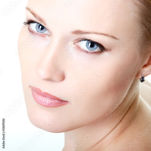 beautiful woman looking at camera, mid adult female face closeup