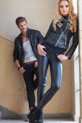 man in leather clothes is checking a woman out