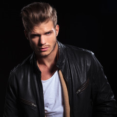 young fashion man in leather jacket