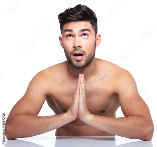 man is looking up to something while praying