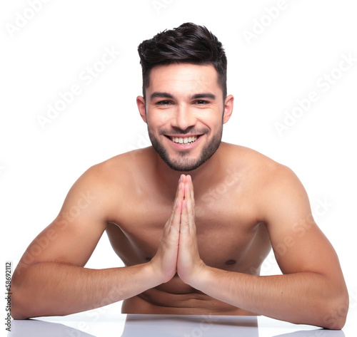 young smiling man is praying
