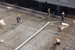 workers make reinforcement for concrete foundation - 58692332