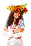 Beautiful ukrainian young woman in garland of summer flowers and