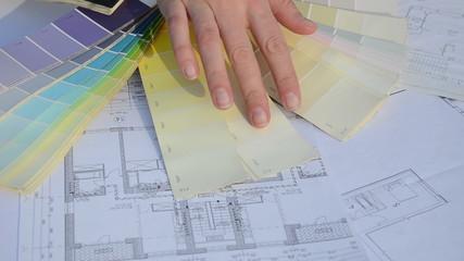 designer woman hand pick proper tint hue color scale palette