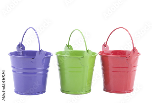 Three buckets of different colors, isolated on white background.