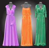 Three long evening of elegant dresses.Gray gradient  background