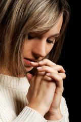 Casual young woman praying.