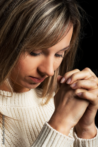 Casual young woman praying.