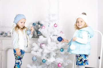 little girls with Christmas tree