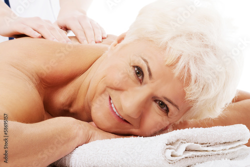 An old woman is having a massage. Spa concept. - 58695157