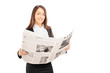 Young businesswoman in black suit holding a newspaper