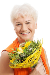 An old woman with bouquet of flowers.