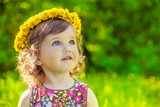 Fototapety Girl with yellow headwreath on