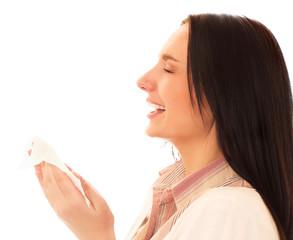 Woman sneezing isolated on white background.