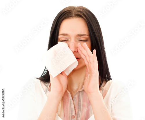 young woman blow one's nose isolated on white background.