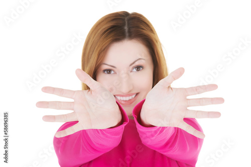 Attractive casual woman with her palms open.