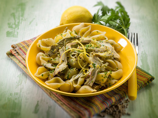 pasta with artichoke lemon peel and cilantro, selective focus