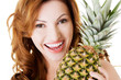 Attractive woman with pineapple.
