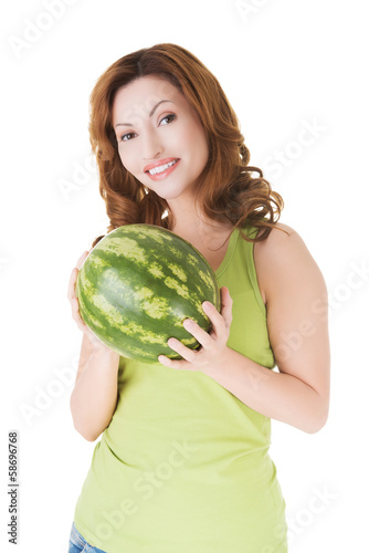 Attractive casual woman holding watermelon.