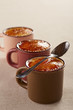 Three cups of creme brulee