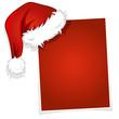 Weihnachtsmütze auf einer Karte