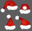 4 verschiedene Weihnachtsmützen auf dunklem Hintergrund