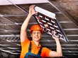 Man installing suspended ceiling