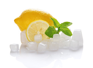 Juicy ripe lemon, mint and cubes of ice